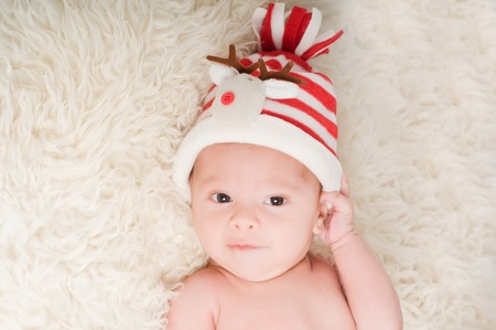 Newborn baby in chritstmas hat photo