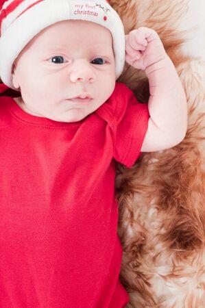 Newborn baby in chritstmas hat photo