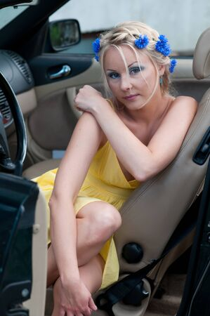 Shot of beautiful woman sitting in car photo