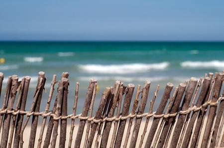 Beach  blue sea, sand and fence