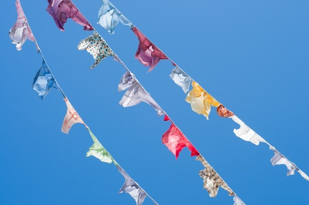 A group of colored shirts on a clothesline Stock Photo - 13091204