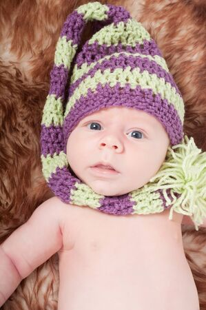 Newborn baby in striped cap photo