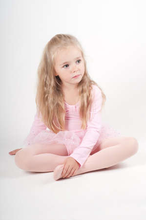 little girl sitting: Ballet dancer sitting on the floor