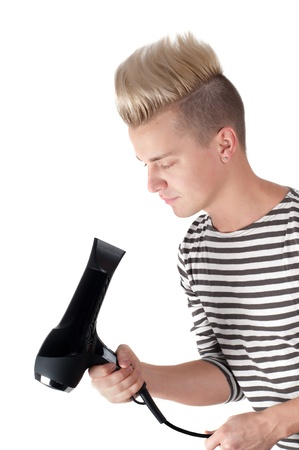 Portrait of handsome man with black hairdryer photo