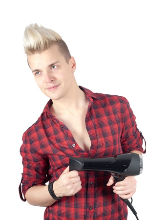 Portrait of handsome man in red with hairdryer photo