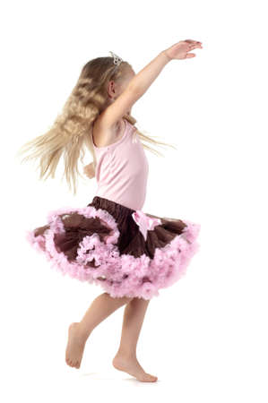 Little girl dancing in studio photo