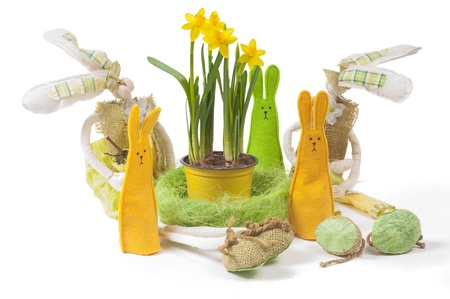 Yellow narcissus in the pot and five bunnies photo