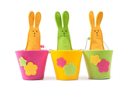 Multicolored easter bunnies sitting in row photo