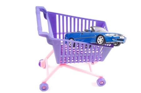 shoppingcart: Conceptual photo with car and shopping-cart Stock Photo