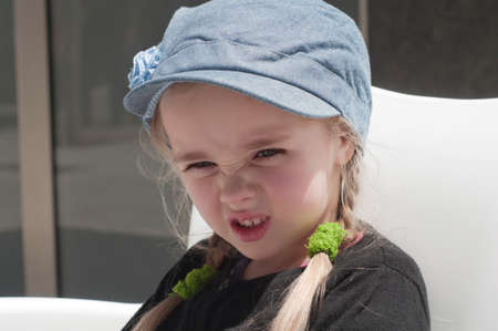 grimacing: Grimacing little girl