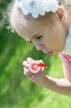 Girl blow bubbles photo