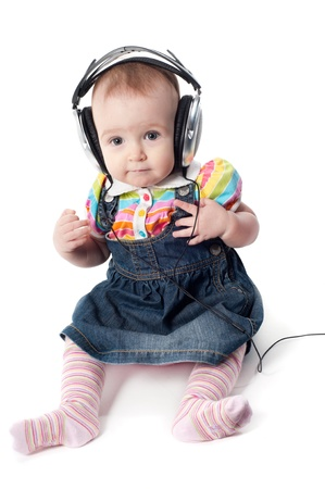 Little cute baby girl in headphones photo