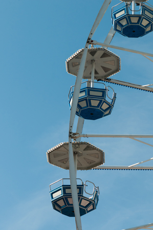 Shot some cabins of ferris wheel over blue sky Stock Photo - 22224597
