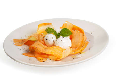 Salad with carrot and mozarella on the white background Stock Photo - 22224602
