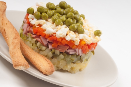 Potato Olivier (russian) salad on the plate Stock Photo - 22224610