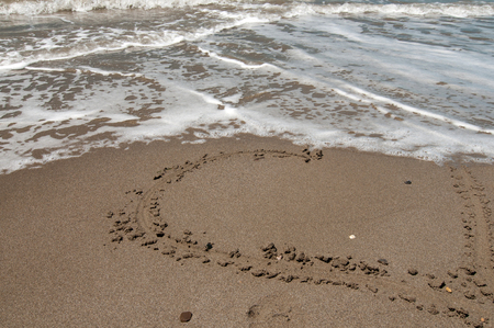 Love heart on the beach washed off a wave Stock Photo - 22347501
