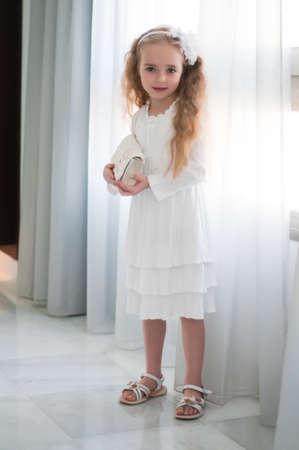 Portrait of beautiful girl standing near white curtain Stock Photo - 22351326