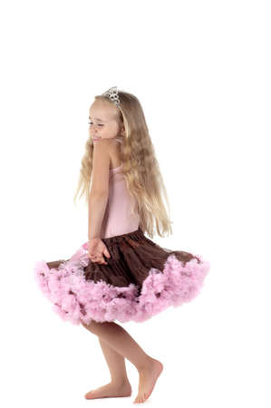 Shot of little dancing girl with long blond hair in studio Stock Photo - 22607758
