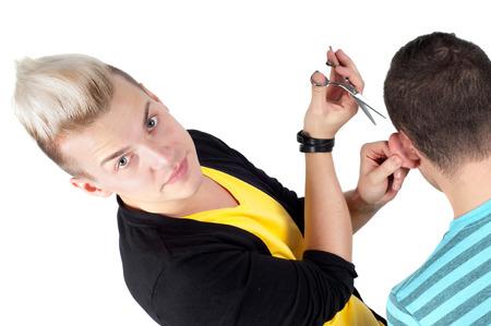 HandsHairdresser working with scissors, studio shooting on whiteome man Stock Photo - 22607782
