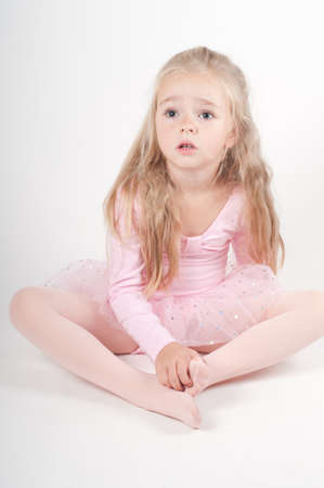 Studio shot of ballet dancer girl in pink photo