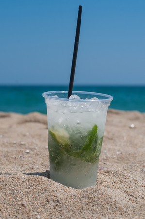 Shot of Mojito cocktail on the beach Stock Photo - 23215395