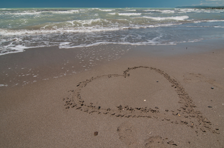Very big love heart shape on the beach photo