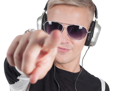 Man with headphones and sunglasses pointing her finger photo