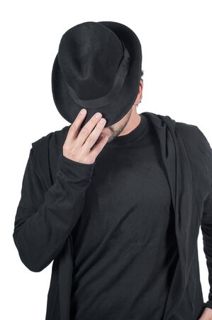 Shot of man who covers his face with his hat photo