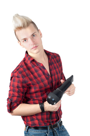 Portrait of handsome man with hairdryer in studio isolated on white photo