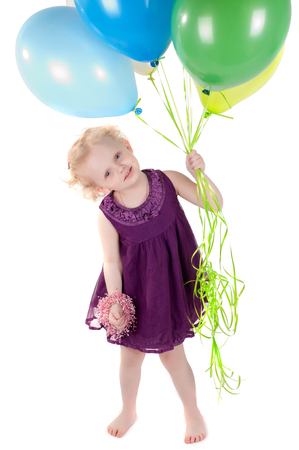 Shot little cute girl in dress with air balloonsisolated on white photo