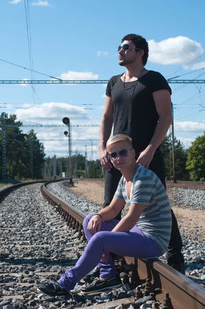 Shot of two young men on train tracks photo