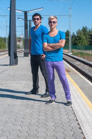 Shot of two young men standing on platform photo