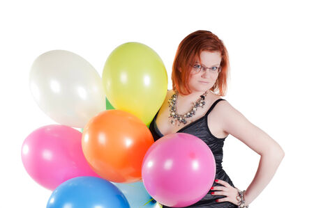Shot of beautiful woman keeping in hand multicolored air balloons photo