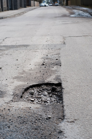 Shot of very big pothole on the road Stock Photo - 26652585