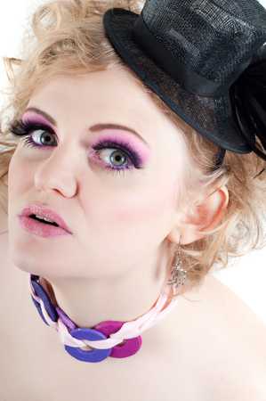 Portrait of young beautiful sexy blonde with fancy make-up photo