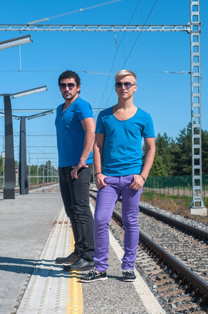 Two young trendy men standing on the platform photo