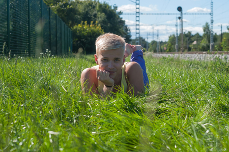 Handsome young man lying on the grass photo
