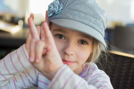 Cute girl showing horn signs photo