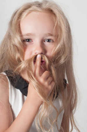 fooling: Little girl with long hair fooling around Stock Photo