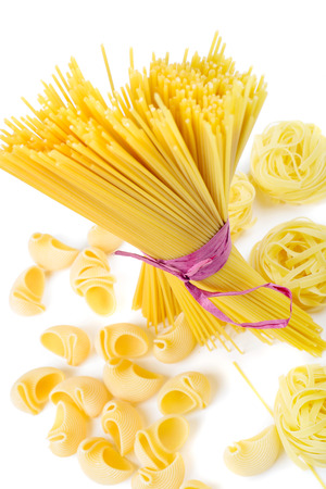 Mixed uncooked raw italian pasta with spaghetti photo