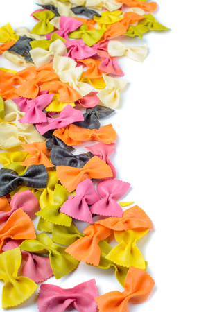 Colored farfalle pasta, on the left edge photo