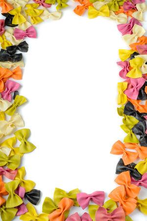 Frane from multicolored farfalle pasta photo