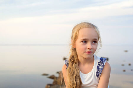 Portrait of little girl on sunset photo