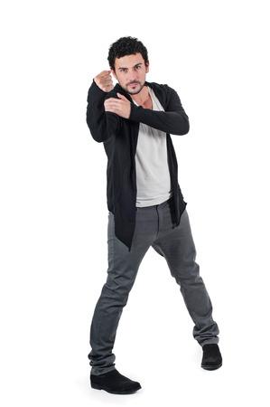 irate: Angry man gesturing fist raised menacing threat