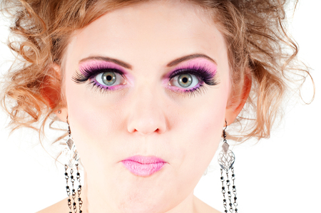 grimacing: Blonde with fancy make-up grimacing Stock Photo