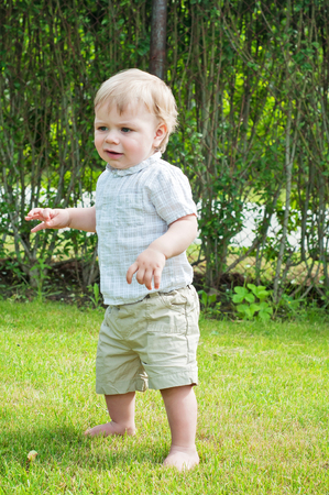 Baby boy doing first steps photo
