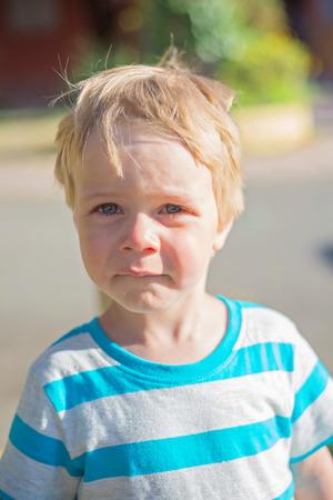 boy crying: Sad little boy