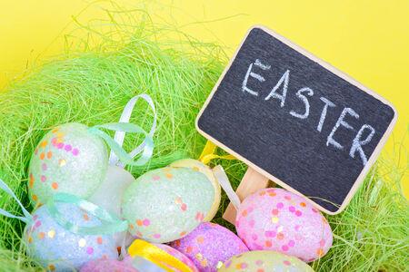 copyspace: Ester eggs in nest with copy-space chalkboard