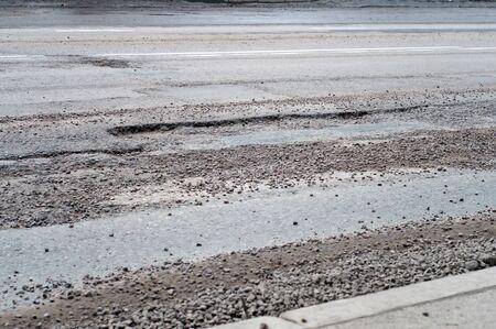 pothole: Large deep pothole