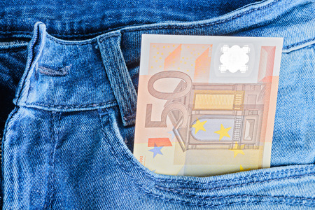 50 euro: 50 Euro banknotes in a blue jeans pocket